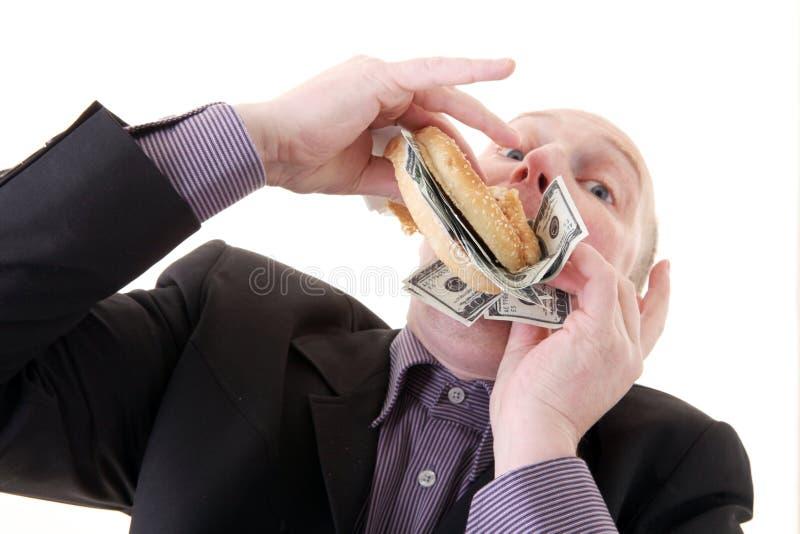 De gierigheid verbruikende dollars van de hebzucht royalty-vrije stock afbeeldingen