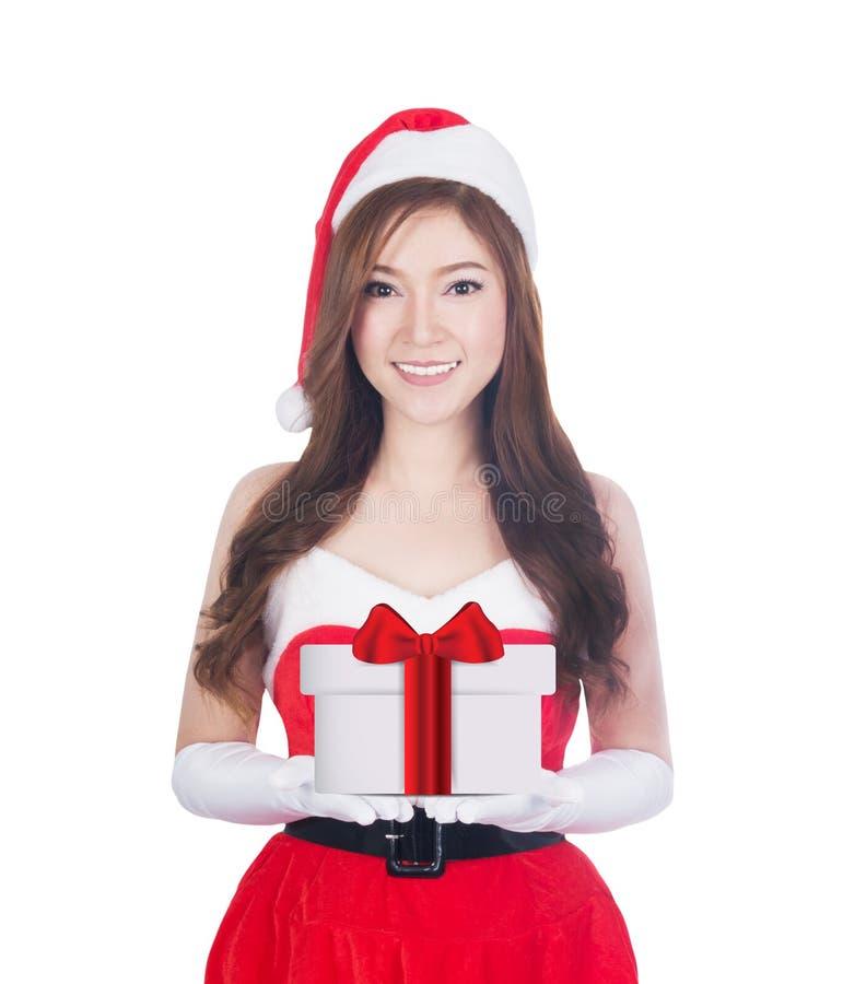 De giften van de holdingskerstmis van de Kerstmisvrouw het glimlachen royalty-vrije stock afbeeldingen