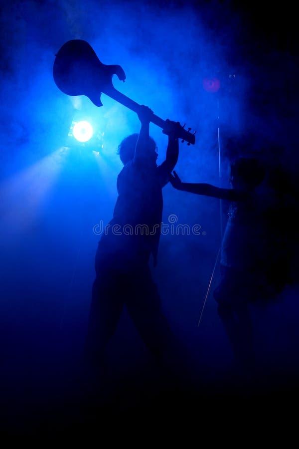 De gitaarineenstorting van het silhouet royalty-vrije stock afbeelding