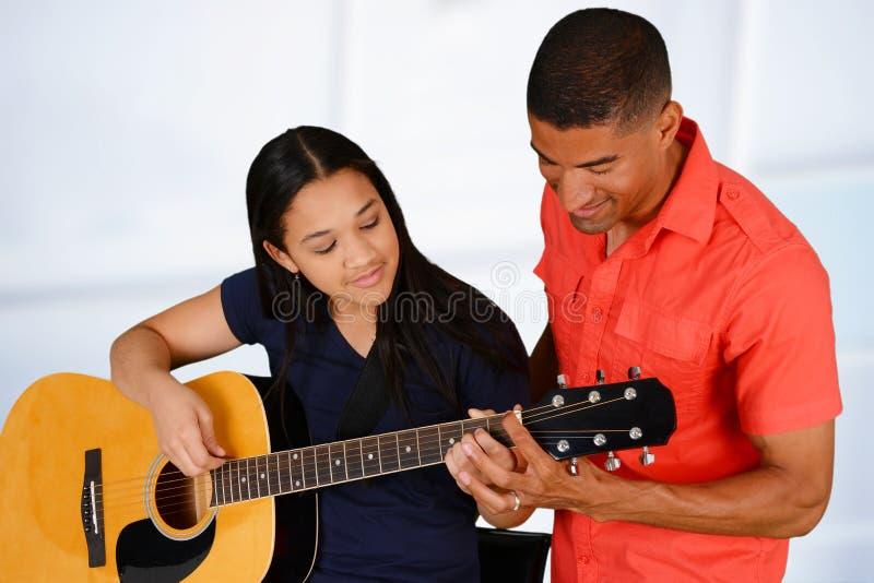 De gitaarspeler van de tiener stock fotografie