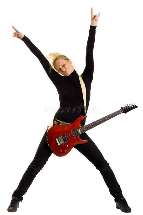 De gitarist van de vrouw met dient de lucht in stock afbeeldingen
