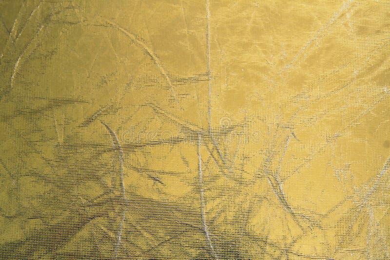 De glanzende achtergrond van de metaal gele textuur Metaal patroon stock foto