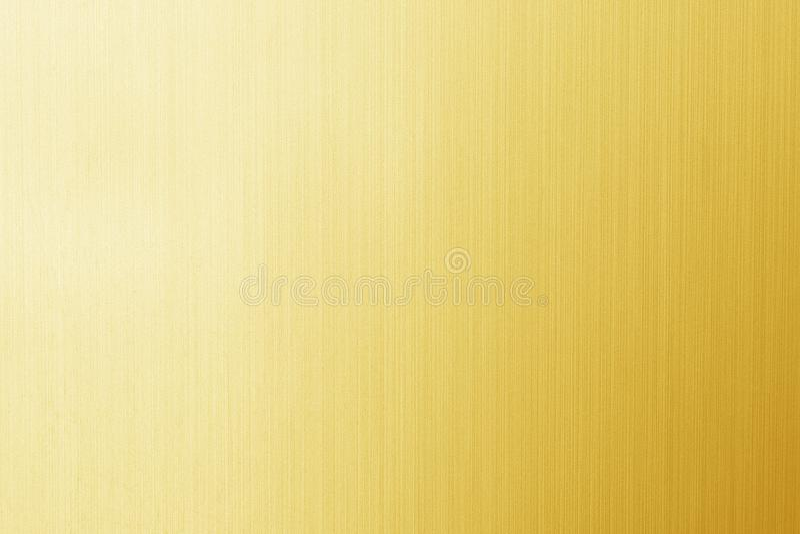 De glanzende gele textuur van de bladgoudfolie stock foto