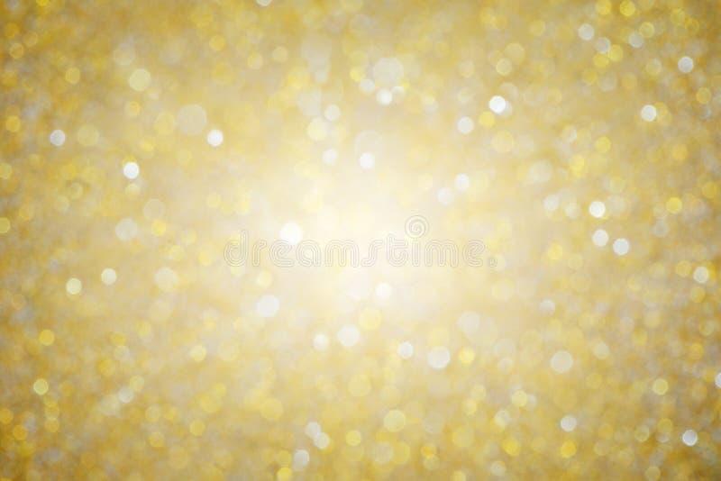 De glanzende gouden achtergrond van de bokehtextuur stock foto