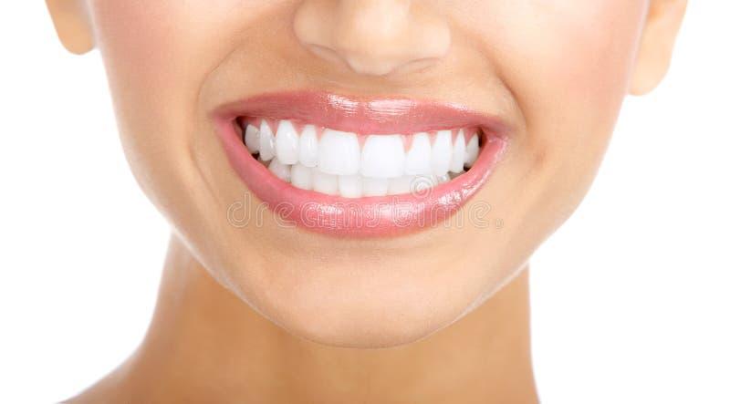 De glimlach en de tanden van de vrouw royalty-vrije stock foto