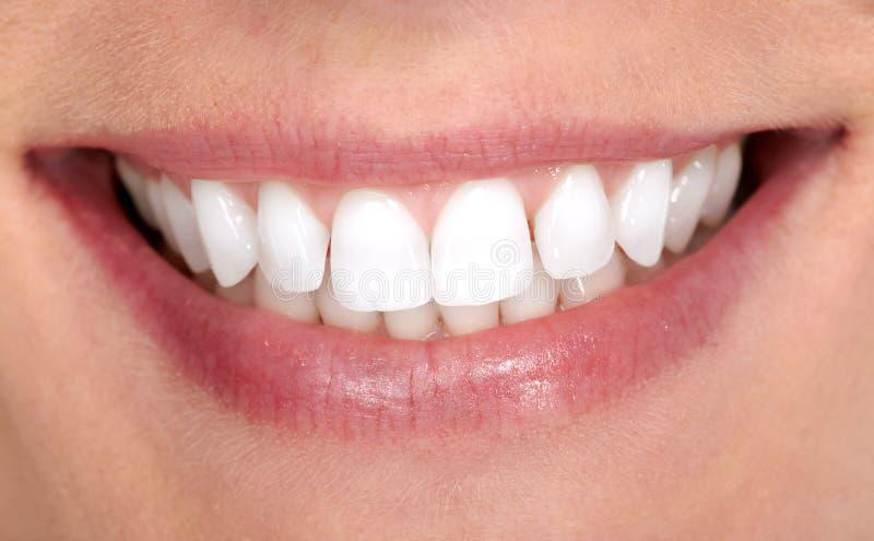 De glimlach en de tanden van de vrouw royalty-vrije stock foto's