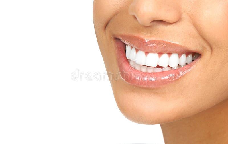 De glimlach van de vrouw royalty-vrije stock afbeelding