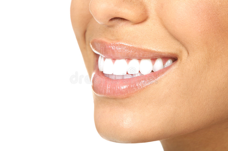 De glimlach van de vrouw stock afbeeldingen