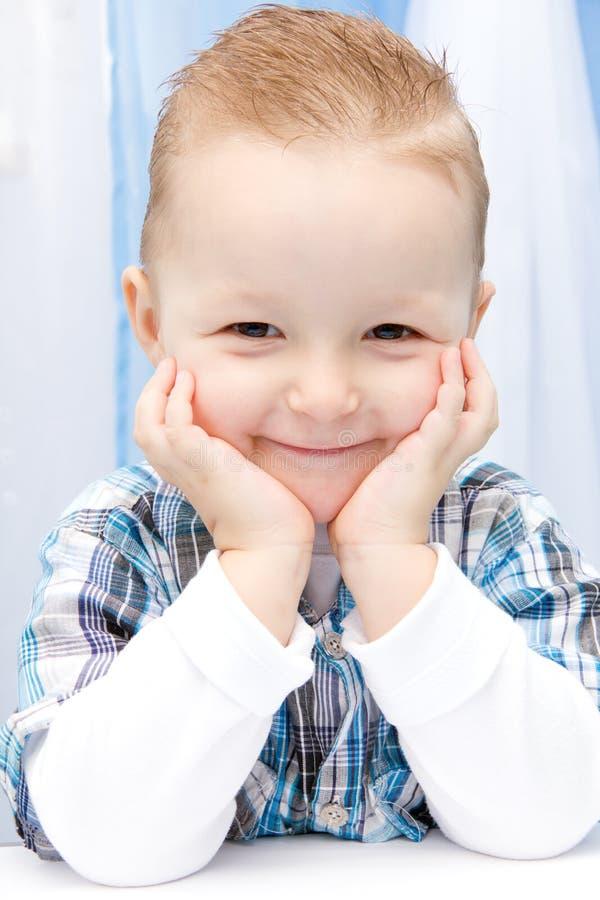 De glimlach van het kind royalty-vrije stock afbeeldingen