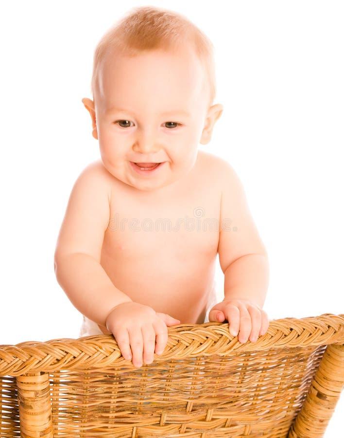 De glimlachende baby kijkt dageraad stock fotografie