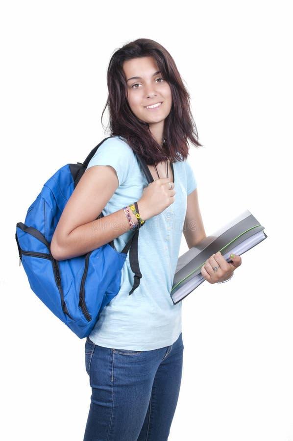 De glimlachende jonge student van de tienermiddelbare school stock foto's