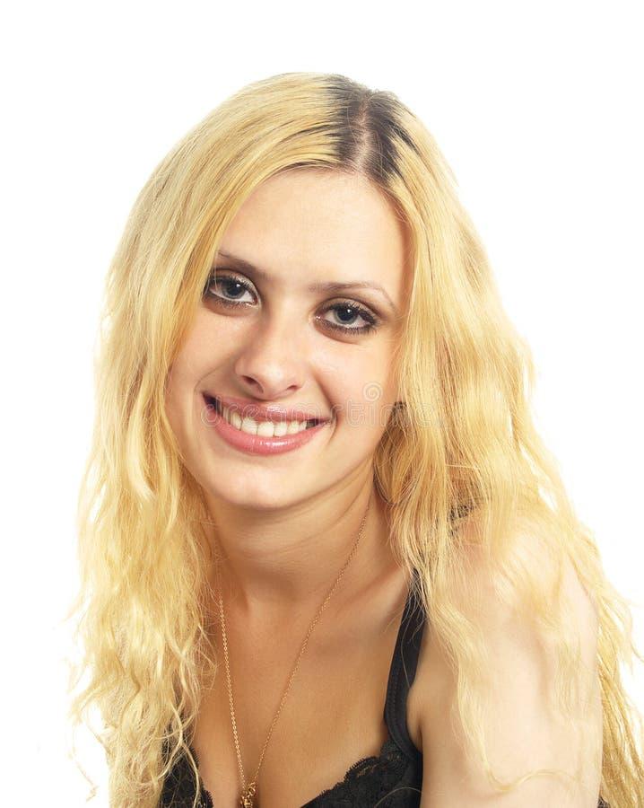 De glimlachende jonge vrouw stock foto's