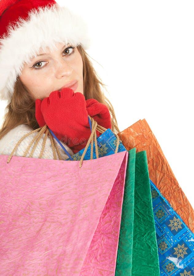 De glimlachende jonge vrouw van de Kerstman stock afbeeldingen