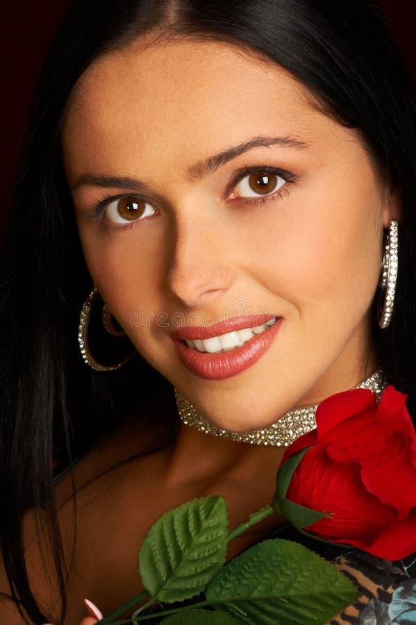 De glimlachende vrouw van de aantrekkingskracht royalty-vrije stock foto