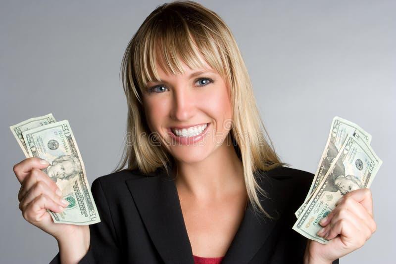 De glimlachende Vrouw van het Geld stock afbeeldingen