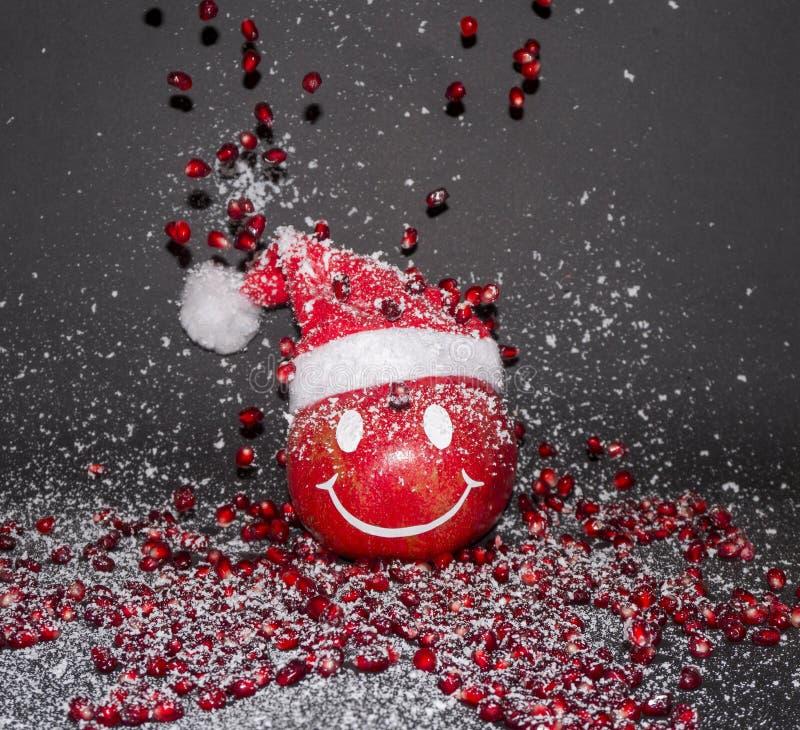 De glimlachgranaatappel, Gelukkig Nieuwjaar, huwt Kerstmis stock afbeeldingen