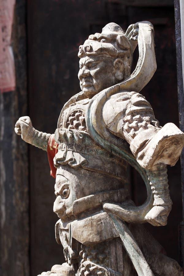 De god van de deur van China. stock foto