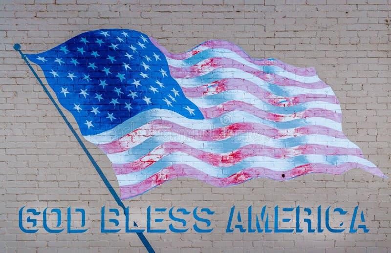 De god zegent Amerika vlag stock foto
