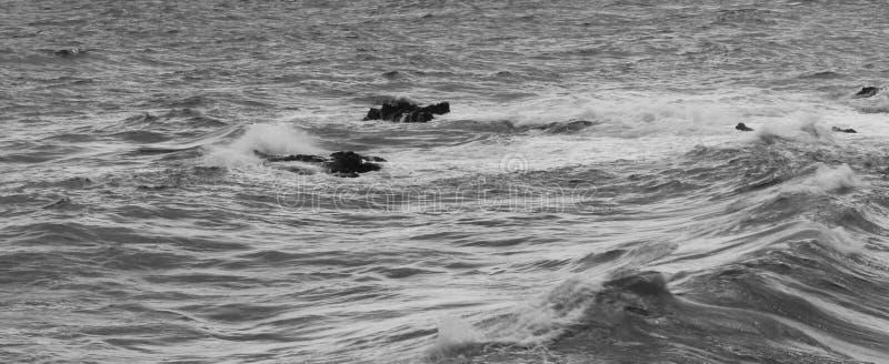 De golfwater van Corsica stock foto's