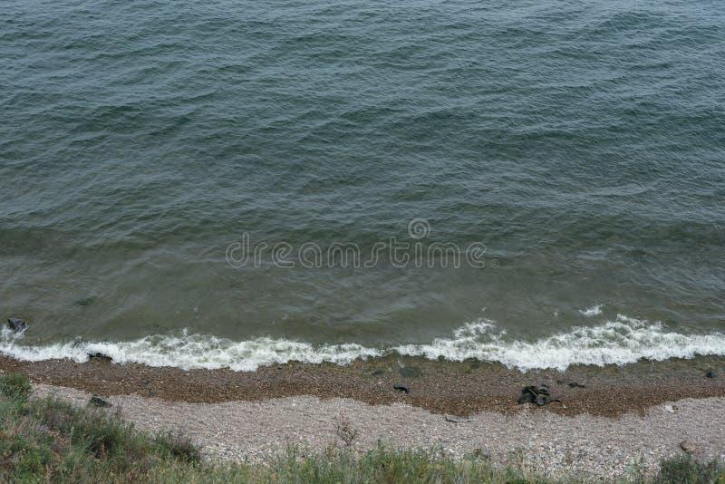 De golven bij de kust royalty-vrije stock foto's
