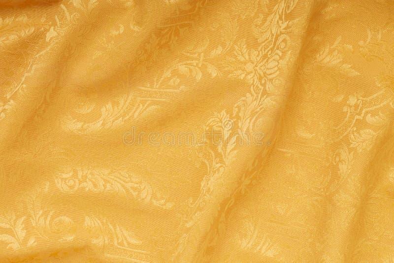 De gouden achtergrond van de damast bloemen golvende textuur royalty-vrije stock fotografie