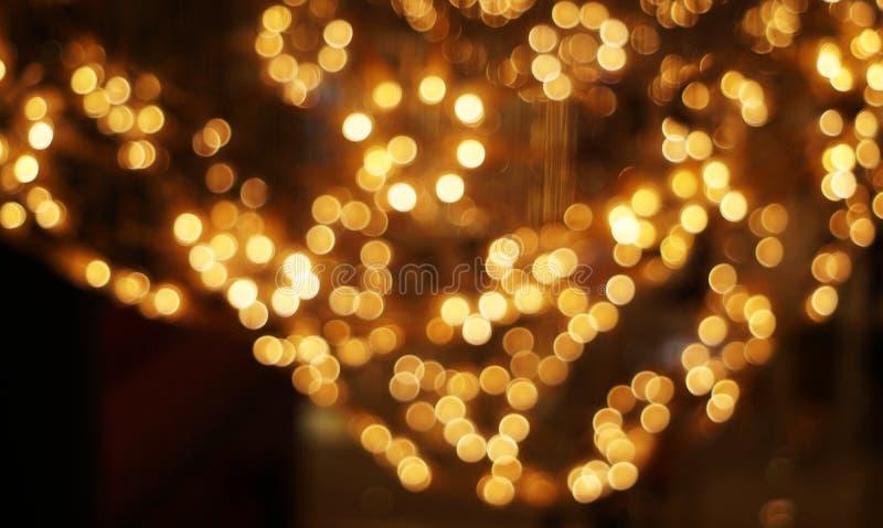 De gouden bokeh vage abstracte achtergrond royalty-vrije stock afbeelding