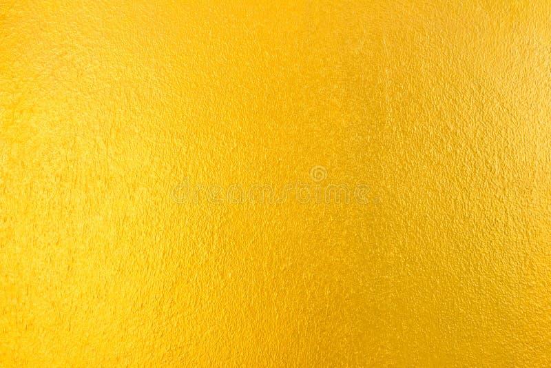De gouden concrete achtergrond van de muurtextuur royalty-vrije stock afbeeldingen