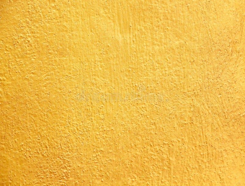 De gouden concrete ruwe patronen van de muur abstracte oude textuur voor achtergrond royalty-vrije stock afbeelding