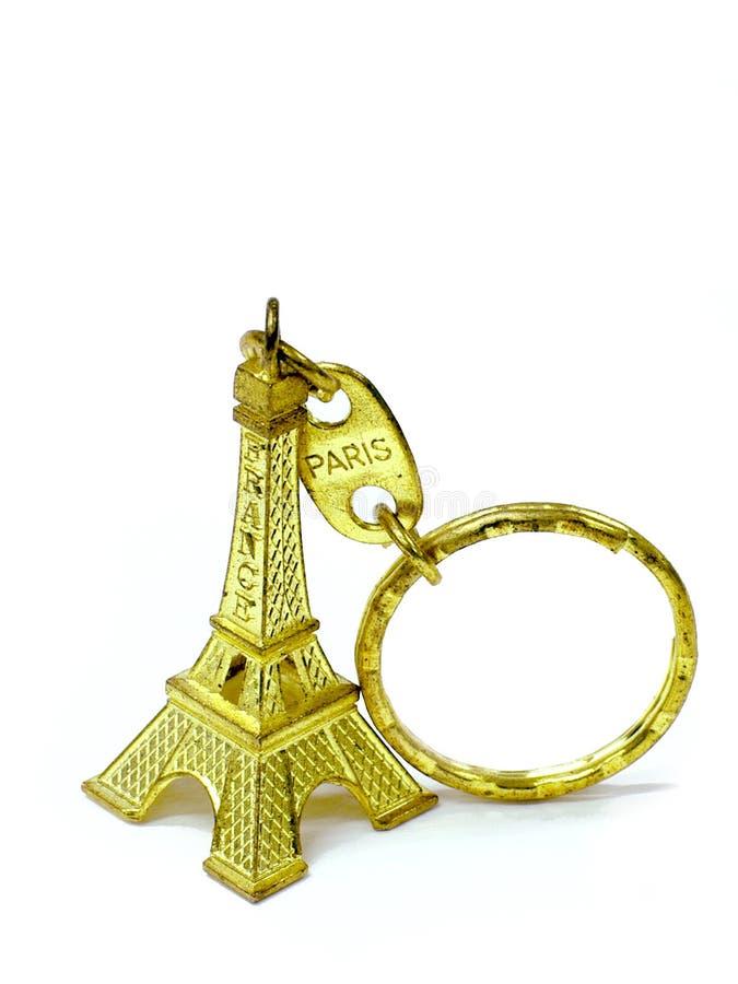 De gouden de toren zeer belangrijke ketting van Eiffel isoleert achtergrond stock foto's