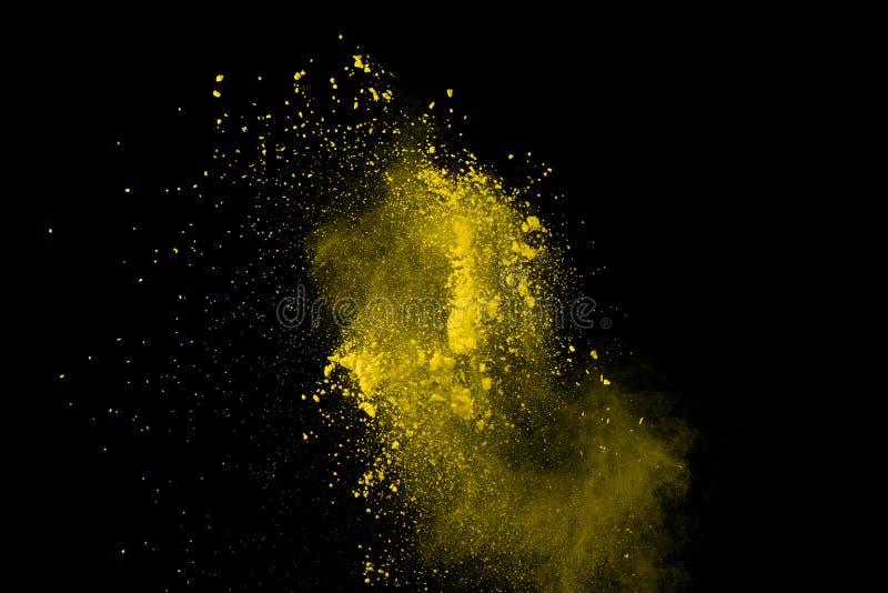 De gouden explosie van poederdeeltjes Schitter uitbarsting met gouden textuur De gele plons van het kleurenstof voor manierachter royalty-vrije stock fotografie