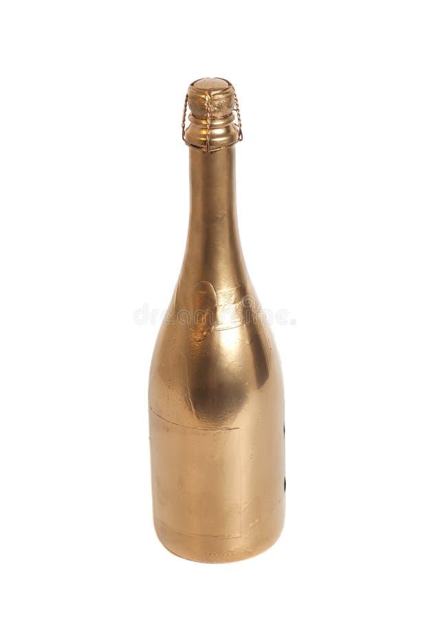 De gouden fles van Champagne royalty-vrije stock afbeeldingen