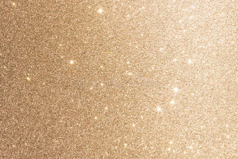 De gouden de Folieachtergrond of Textuur schittert Fonkeling vertroebelde Lichten stock foto's