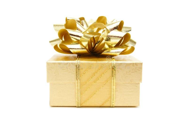 De gouden gift van Kerstmis stock fotografie