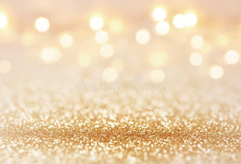 De gouden kleurensamenvatting schittert textuurachtergrond voor vakantie royalty-vrije stock fotografie