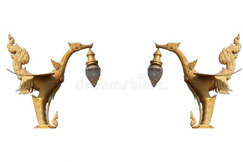 De gouden kunstgeheimzinnigheid vogel, Lantaarnhanger ontwierp zwaanstandbeeld dat op witte achtergrond, Traditionele oude unieke stock foto