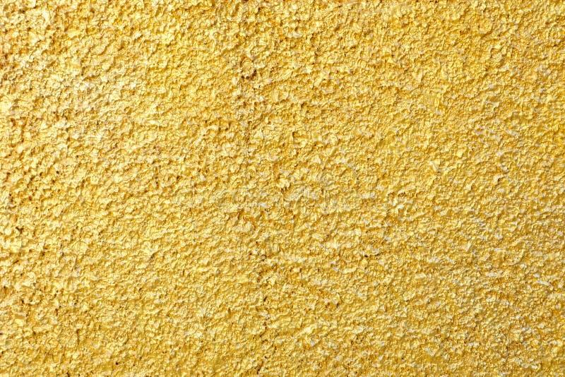 De gouden Muur van de Verfgipspleister stock afbeelding