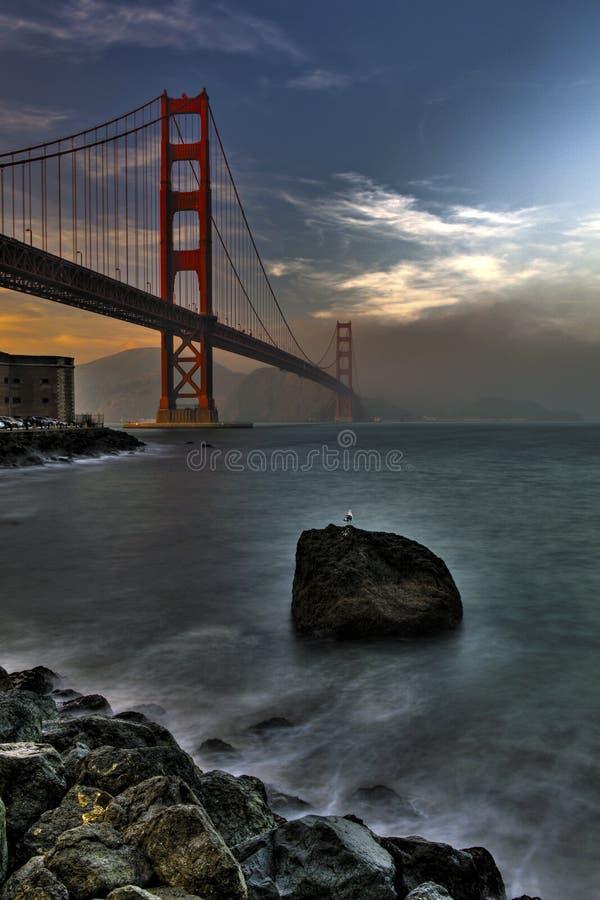 De gouden zonsondergang van de Brug van de Poort stock foto