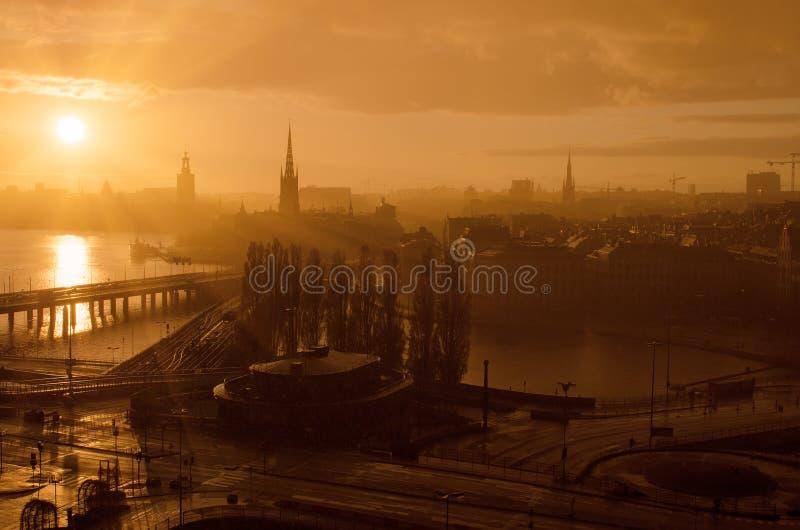 De gouden zonsondergang van Stockholm stock afbeeldingen