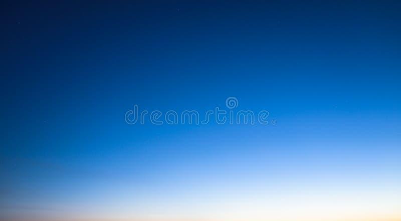 De gradiënt van de zonsonderganghemel stock afbeeldingen