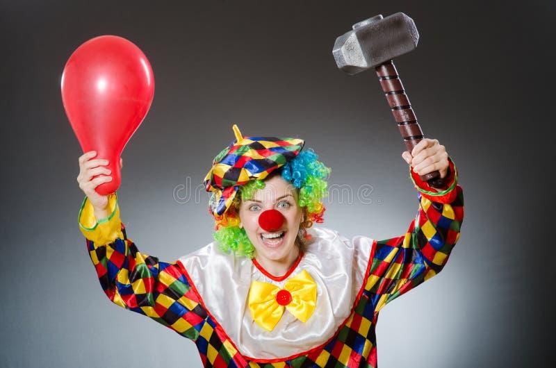 De grappige clown in komisch concept royalty-vrije stock afbeelding