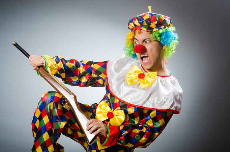 De grappige clown in komisch concept stock afbeeldingen