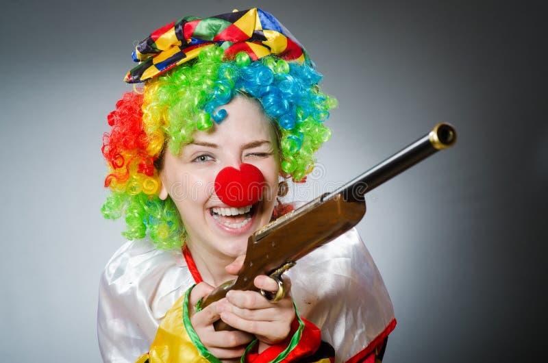 De grappige clown in komisch concept stock afbeelding