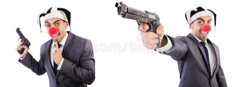 De grappige clownzakenman met pistool stock afbeelding