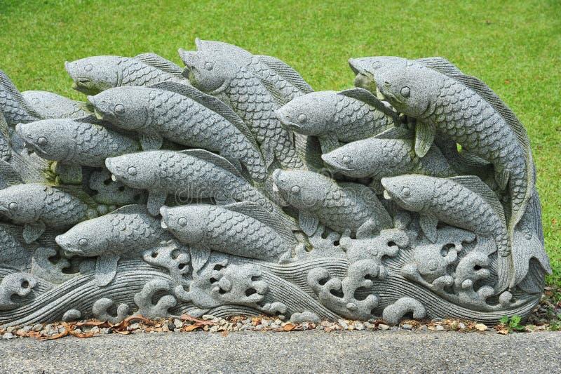 De Gravure van de Steen van Koi stock afbeelding