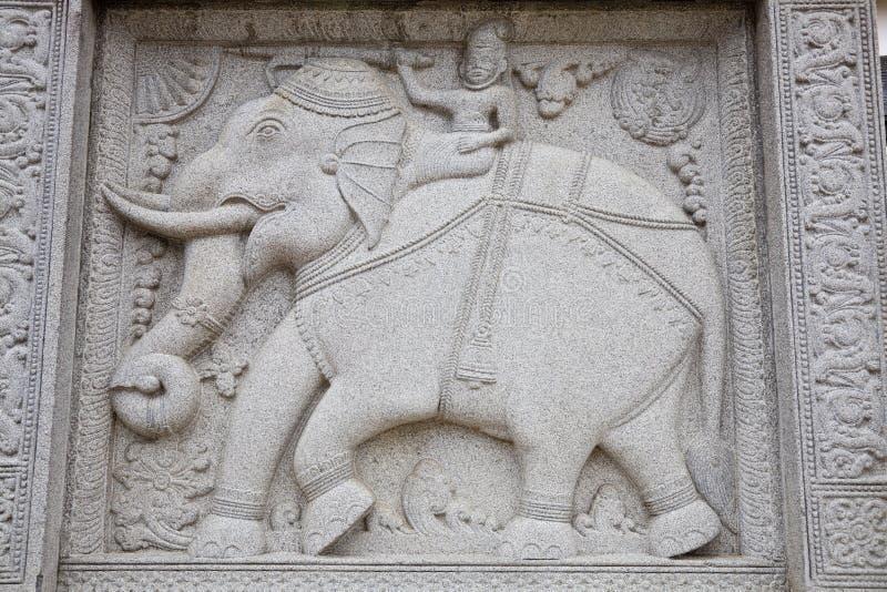 De gravure van de steen van olifant in boeddhistische tempel royalty-vrije stock foto's