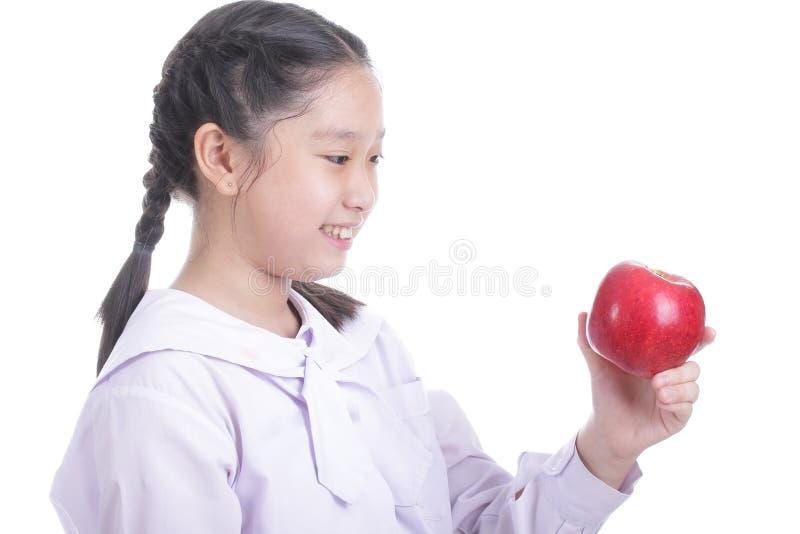 De greep rode appel van het studentenmeisje stock foto