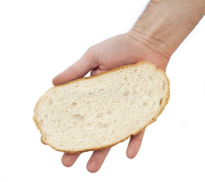 De greep van de hand een boterham. royalty-vrije stock afbeelding