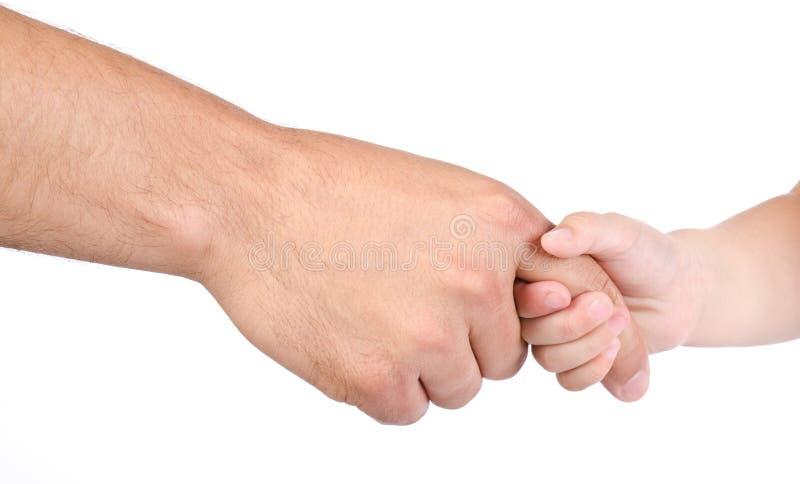 De greep van het kind de vinger van vader stock foto's