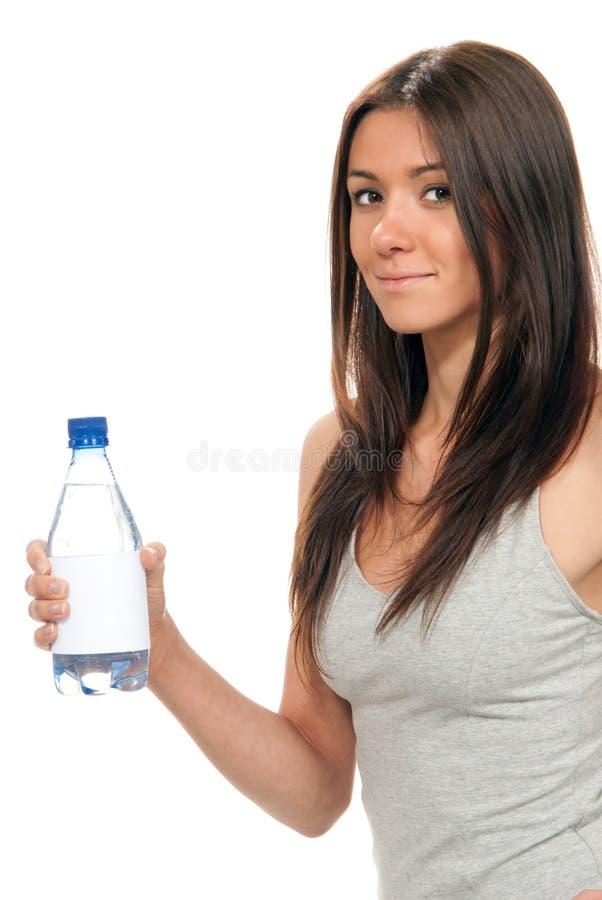 De greepfles van het meisje zuiver nog drinkwater royalty-vrije stock foto's