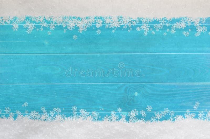 De Grens van de Kerstmissneeuwvlok op Blauw Hout royalty-vrije stock afbeelding